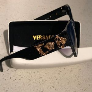 Versace limited edition sunglasses with a case.